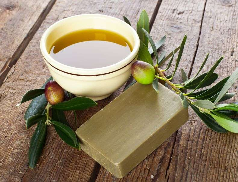 aleppo soap and olives on wooden table